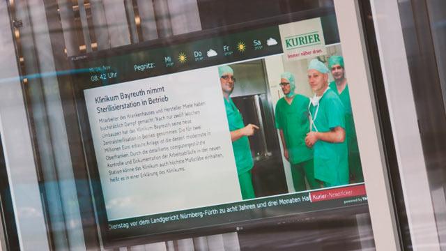Digital Signage Nordbayerischer Kurier SiG5 Monitor in Schaufenster
